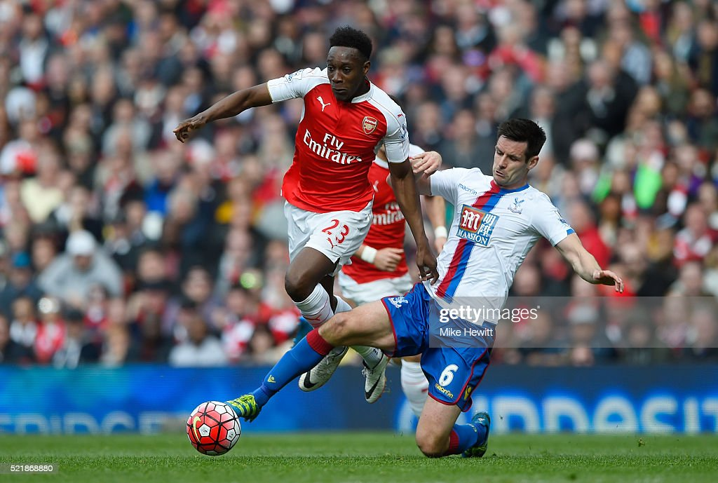 Danny Welbeck of Arsenal is tackled by Scott Dann of Crystal Palace during the Barclays Premier League match between Arsenal and Crystal Palace at the Emirates Stadium on April 17, 2016 in London, England.