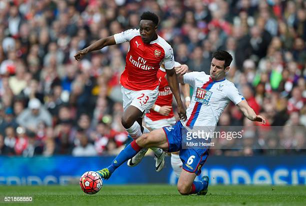 Danny Welbeck of Arsenal is tackled by Scott Dann of Crystal Palace during the Barclays Premier League match between Arsenal and Crystal Palace at...