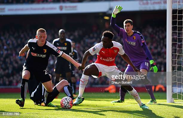 Danny Welbeck of Arsenal is watched by Ben Watson and Costel Pantilimon of Watford during the Emirates FA Cup sixth round match between Arsenal and...
