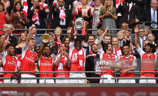 Danny Welbeck of Arsenal lifts the FA Cup Trophy after the match between Arsenal and Chelsea at Wembley Stadium on May 27 2017 in London England