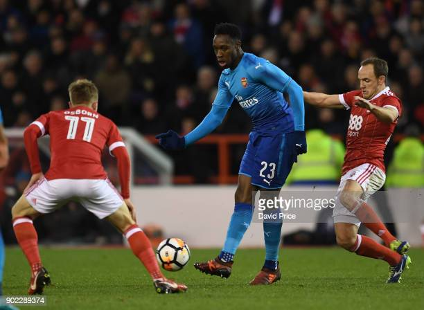 Danny Welbeck of Arsenal passes the ball under pressure from David Vaughan and Ben Osborn of Forest during the Emirates FA Cup 3rd Round match...