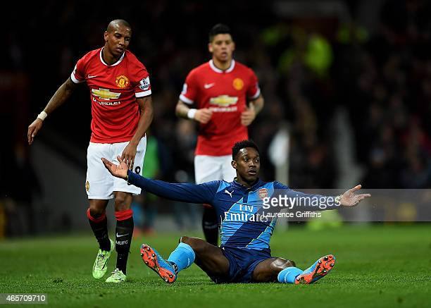 Danny Welbeck of Arsenal recats after being brought down by Ashley Young of Manchester United during the FA Cup Quarter Final match between...