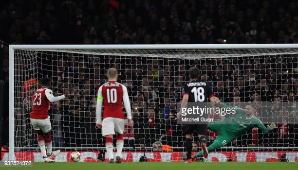 Danny Welbeck of Arsenal scores a goal from a penalty during the Europa League match between Arsenal and AC Milan at The Emirates Stadium on March 15...