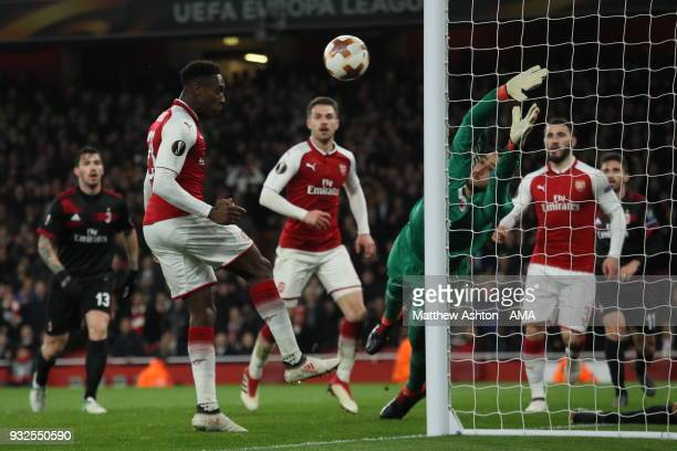 Danny Welbeck of Arsenal scores a goal to make it 31 during the UEFA Europa League Round of 16 Second Leg match between Arsenal and AC Milan at...
