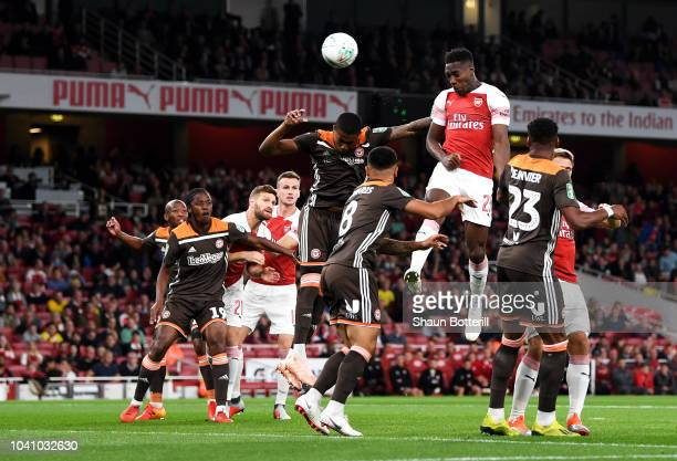 Danny Welbeck of Arsenal scores his sides first goal during the Carabao Cup Third Round match between Arsenal and Brentford at Emirates Stadium on...