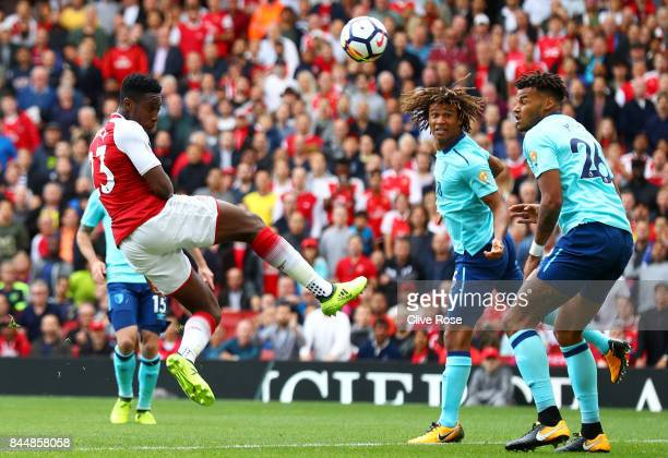 Danny Welbeck of Arsenal scores his sides first goal during the Premier League match between Arsenal and AFC Bournemouth at Emirates Stadium on...