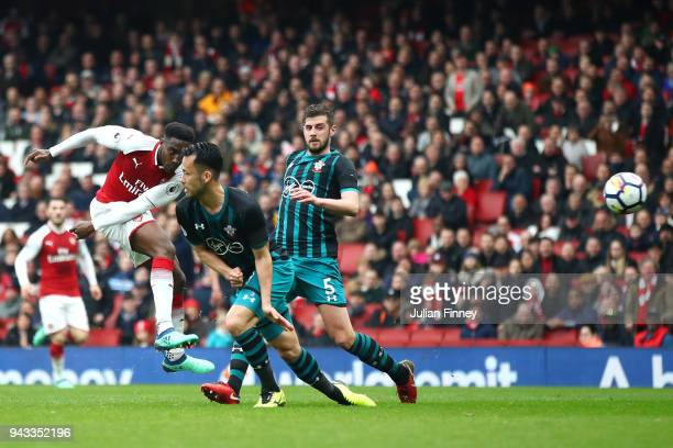 Danny Welbeck of Arsenal scores his sides second goal during the Premier League match between Arsenal and Southampton at Emirates Stadium on April 8...