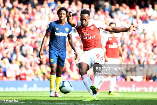 Danny Welbeck of Arsenal scores his sides third goal during the Premier League match between Arsenal FC and West Ham United at Emirates Stadium on...