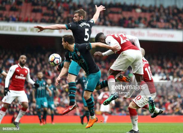 Danny Welbeck of Arsenal scores his sides third goal during the Premier League match between Arsenal and Southampton at Emirates Stadium on April 8...