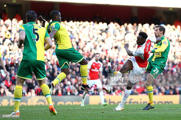 Danny Welbeck of Arsenal scores the opening goal during the Barclays Premier League match between Arsenal and Norwich City at The Emirates Stadium on...