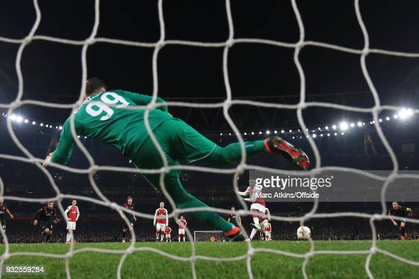 Danny Welbeck of Arsenal scores their 1st goal from the penalty spot past Gianluigi Donnarumma of AC Milan during the UEFA Europa League Round of 16...