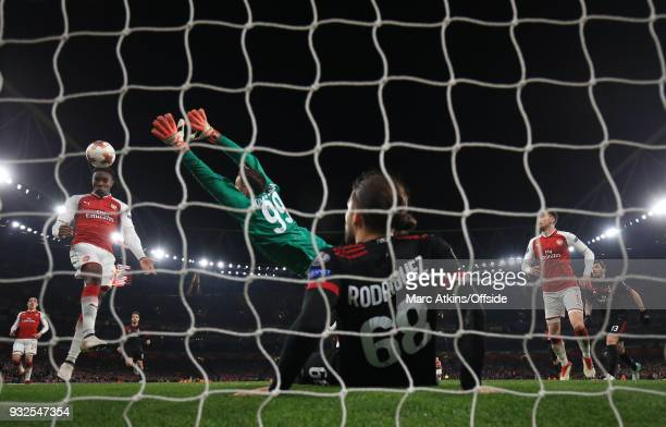 Danny Welbeck of Arsenal scores their 3rd goal during the UEFA Europa League Round of 16 2nd leg match between Arsenal and AC MIian at Emirates...