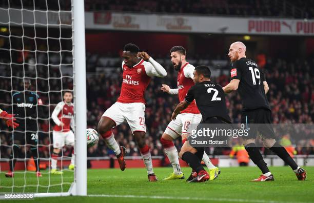 Danny Welbeck of Arsenal scores their first goal during the Carabao Cup QuarterFinal match between Arsenal and West Ham United at Emirates Stadium on...
