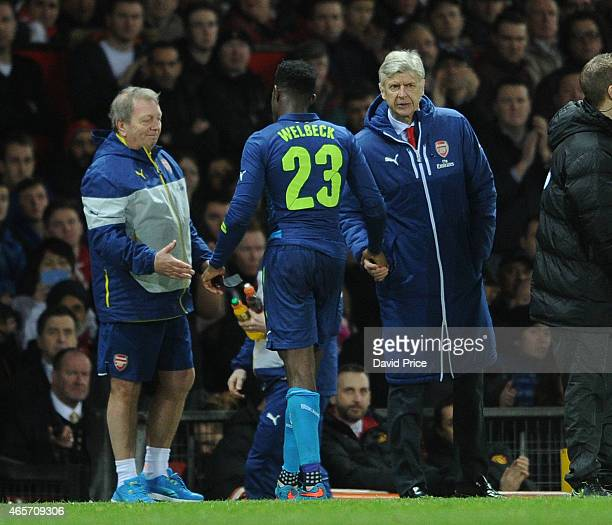 Danny Welbeck of Arsenal shakes hands with Arsenal Manager Arsene Wenger during the match between Manchester United and Arsenal in the FA Cup 6th...