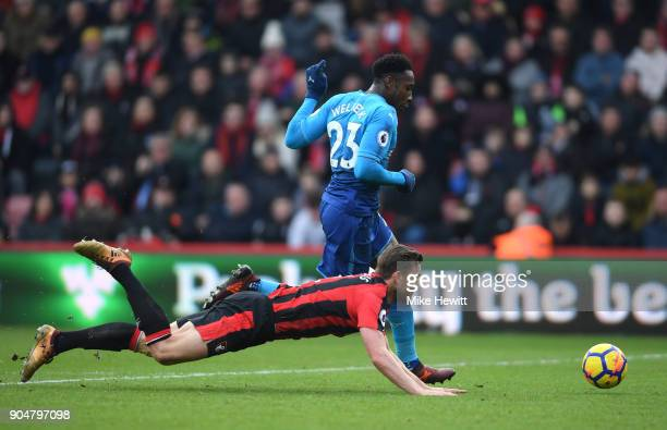 Danny Welbeck of Arsenal shoots as he goes past Simon Francis of AFC Bournemouth during the Premier League match between AFC Bournemouth and Arsenal...
