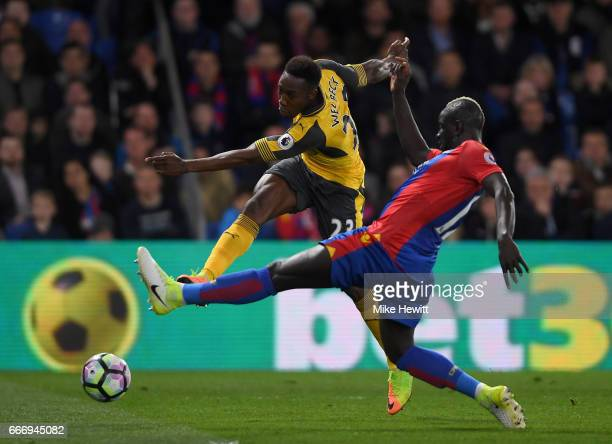 Danny Welbeck of Arsenal shoots past Mamadou Sakho of Crystal Palace during the Premier League match between Crystal Palace and Arsenal at Selhurst...