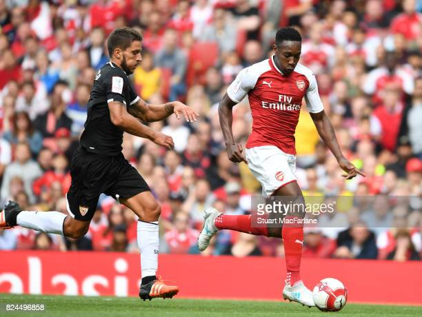 Danny Welbeck of Arsenal takes on Daniel Carrico of Seville during the Emirates Cup match between Arsenal and Seville at Emirates Stadium on July 30...