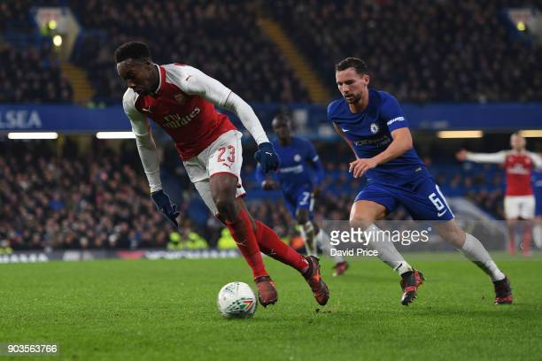 Danny Welbeck of Arsenal takes on Danny Drinkwater of Chelsea during the Carabao Cup Semie Final 1st leg match between Chelsea and Arsenal at...