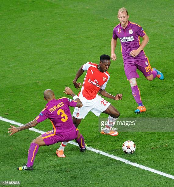 Danny Welbeck of Arsenal takes on Felipe Melo and Semih Kaya of Galatasaray during the UEFA Champions League group match between Arsenal and...