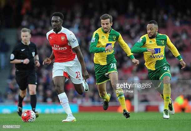 Danny Welbeck of Arsenal takes on Gary O'Neil and Nathan Redmond of Norwich during the Barclays Premier League match between Arsenal and Norwich City...