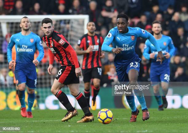 Danny Welbeck of Arsenal takes on Lewis Cook of Bournemouth during the Premier League match between AFC Bournemouth and Arsenal at Vitality Stadium...
