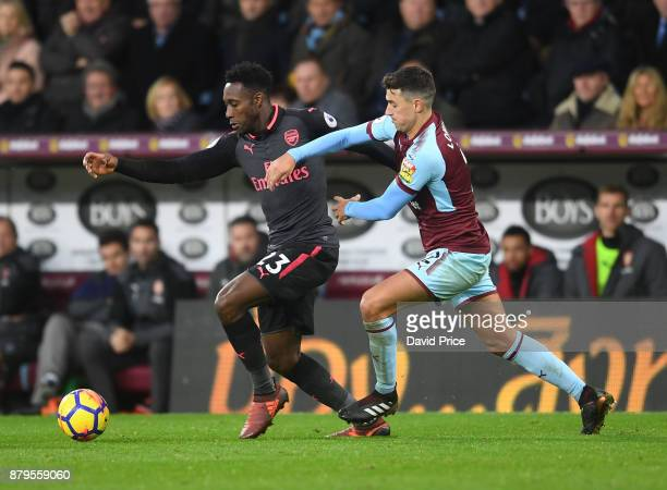 Danny Welbeck of Arsenal takes on Matthew Lowton of Burnely during the Premier League match between Burnley and Arsenal at Turf Moor on November 26...
