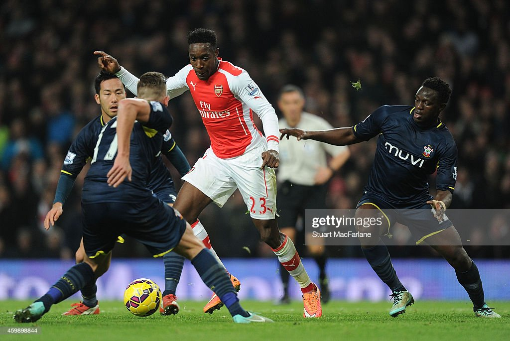 Danny Welbeck of Arsenal takes on on (L) Toby Alderweireld and (R) Victor Wanyama of Southampton during the Barclays Premier League match between Arsenal and Southampton at Emirates Stadium on December 3, 2014 in London, England.