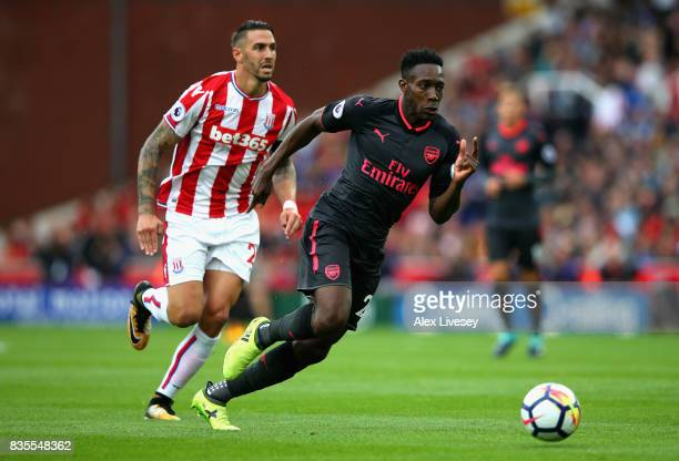 Danny Welbeck of Arsenal takes the ball away from Geoff Cameron of Stoke City during the Premier League match between Stoke City and Arsenal at...