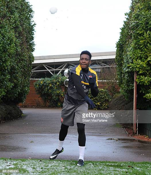 Danny Welbeck of Arsenal throws a snowball before a training session at London Colney on January 13 2017 in St Albans England