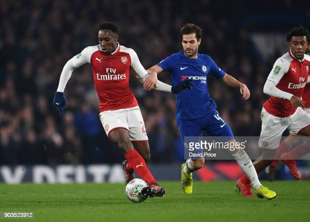 Danny Welbeck of Arsenal under pressure from Cesc Fabregas of Chelsea during the Carabao Cup Semie Final 1st leg match between Chelsea and Arsenal at...