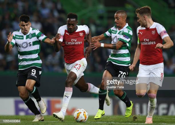 Danny Welbeck of Arsenal with Marcos Acuna of Sporting CP and Bruno Gaspar of Sporting CP during the UEFA Europa League Group E match between...