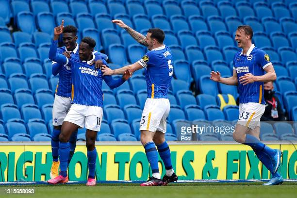 Danny Welbeck of Brighton and Hove Albion celebrates with team mates after scoring their side's second goal during the Premier League match between...