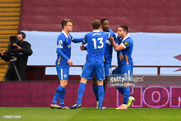 Danny Welbeck of Brighton and Hove Albion celebrates with teammates Pascal Gross and Neal Maupay after scoring his team's first goal during the...