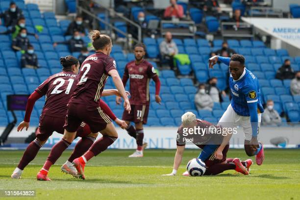 Danny Welbeck of Brighton and Hove Albion is challenged by Ezgjan Alioski of Leeds United leading to a penalty being awarded during the Premier...