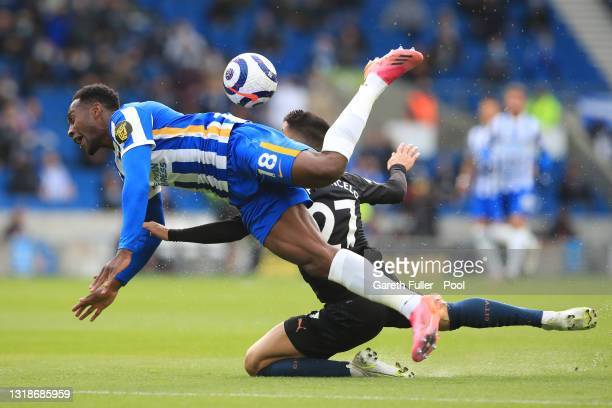 Danny Welbeck of Brighton and Hove Albion is challenged by Joao Cancelo of Manchester City leading to a penalty being awarded during the Premier...