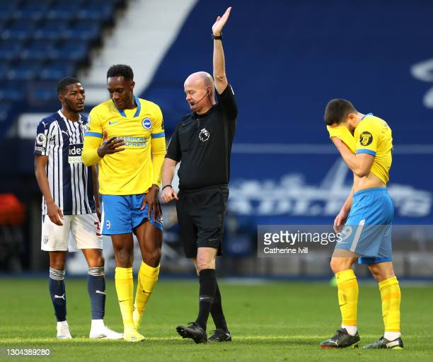 Danny Welbeck of Brighton and Hove Albion reacts after missing a penalty as referee Lee Mason gestures during the Premier League match between West...