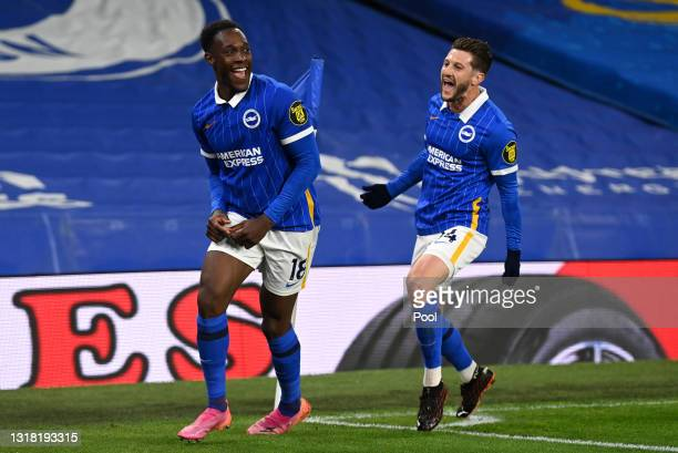 Danny Welbeck of Brighton & Hove Albion celebrates with Adam Lallana after scoring his team's first goal during the Premier League match between...