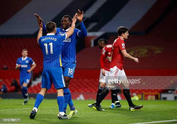 Danny Welbeck of Brighton & Hove Albion celebrates with teammate Leandro Trossard after scoring their team's first goal during the Premier League...