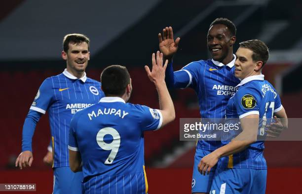 Danny Welbeck of Brighton & Hove Albion celebrates with teammates Pascal Gross, Neal Maupay and Leandro Trossard after scoring their team's first...