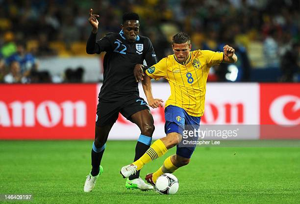 Danny Welbeck of England and Anders Svensson of Sweden during the UEFA EURO 2012 group D match between Sweden and England at The Olympic Stadium on...