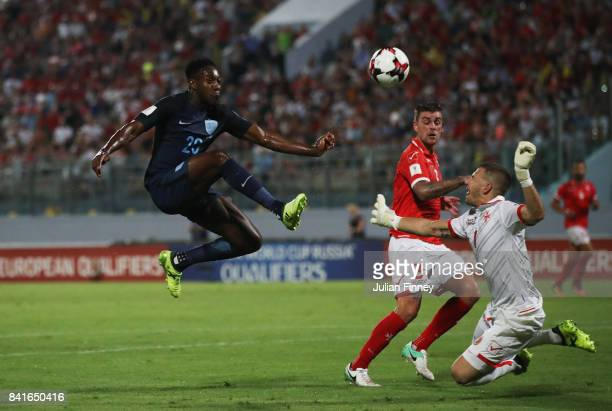 Danny Welbeck of England beats goalkeeper Andrew Hogg of Malta as he scores their third goal during the FIFA 2018 World Cup Qualifier between Malta...