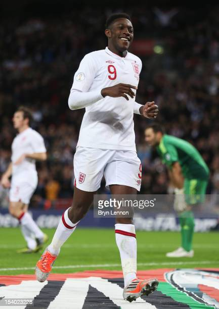 Danny Welbeck of England celebrates after scoring his team's fourth goal during the FIFA 2014 World Cup Group H qualifying match between England and...
