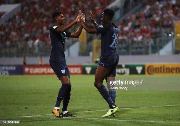 Danny Welbeck of England celebrates as he scores their third goal with Marcus Rashford of England during the FIFA 2018 World Cup Qualifier between...