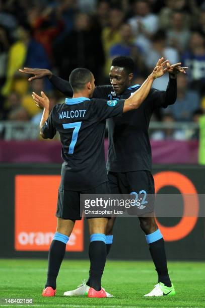 Danny Welbeck of England celebrates scoring their third goal Theo Walcott of England during the UEFA EURO 2012 group D match between Sweden and...