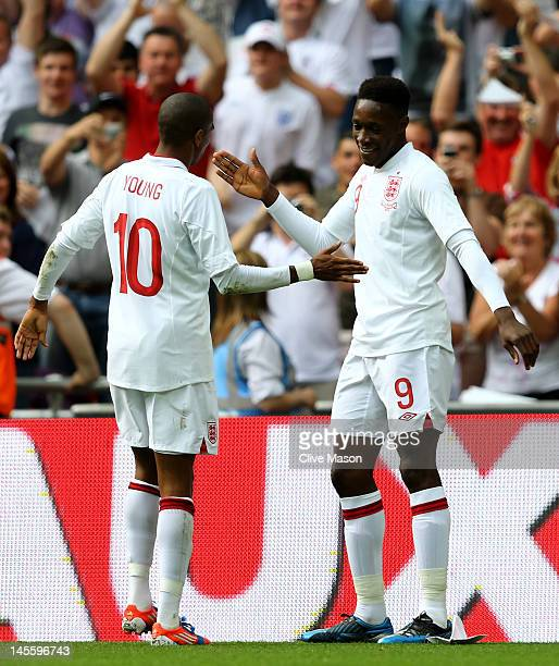 Danny Welbeck of England celebrates with Ashley Young after scoring the first goal of the match during the international friendly match between...