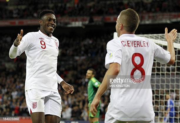 Danny Welbeck of England celebrates with midfielder Tom Cleverley after scoring his second goal and England's fourth during the 2014 World Cup...
