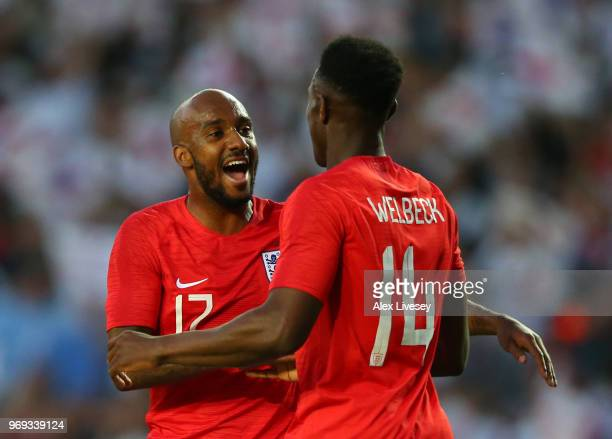 Danny Welbeck of England celebrates with team mate Fabian Delph of England after scoring his sides second goal during the International Friendly...