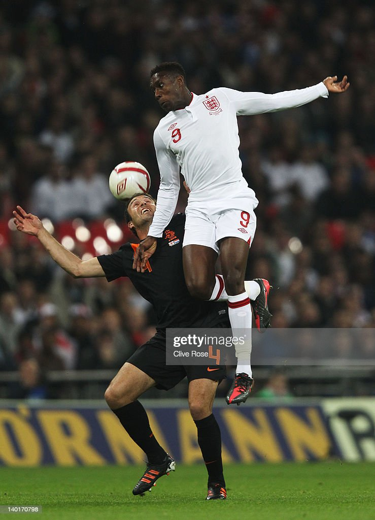 Danny Welbeck (R) of England jumps for the ball with Joris Mathijsen of Netherlands during the international friendly match between England and Netherlands at Wembley Stadium on February 29, 2012 in London, England.