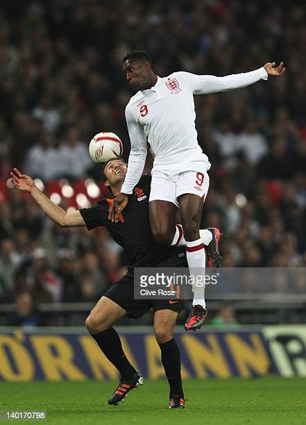 Danny Welbeck of England jumps for the ball with Joris Mathijsen of Netherlands during the international friendly match between England and...