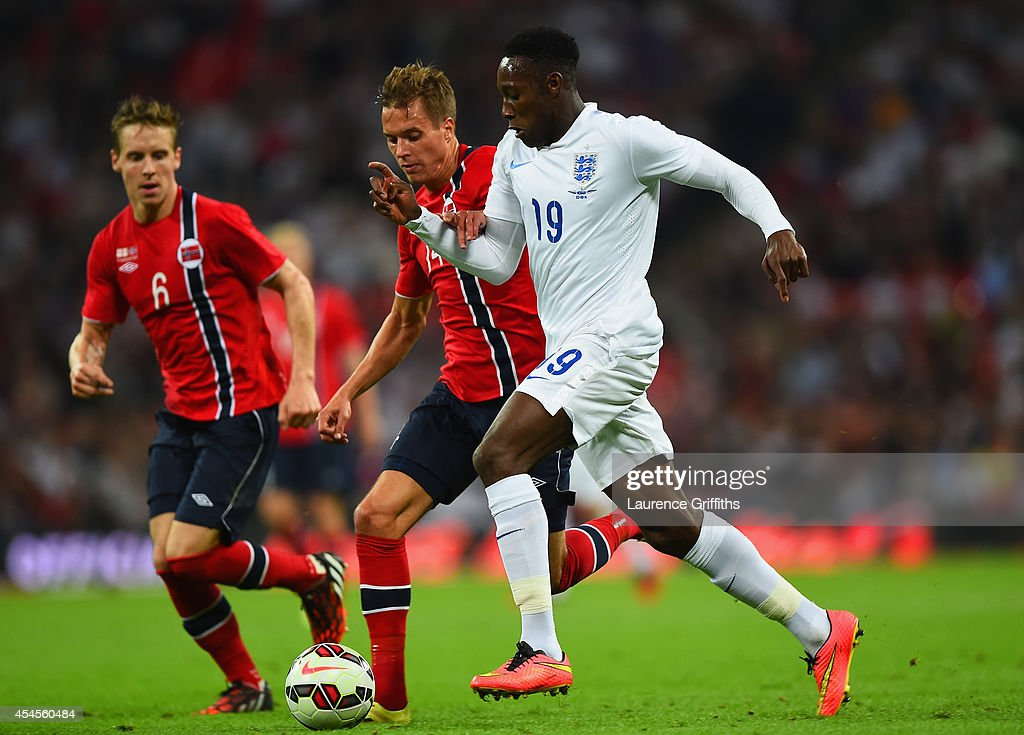 Danny Welbeck of England runs past Anders Konradsen of Norway during the International friendly match between England and Norway at Wembley Stadium on September 3, 2014 in London, England.
